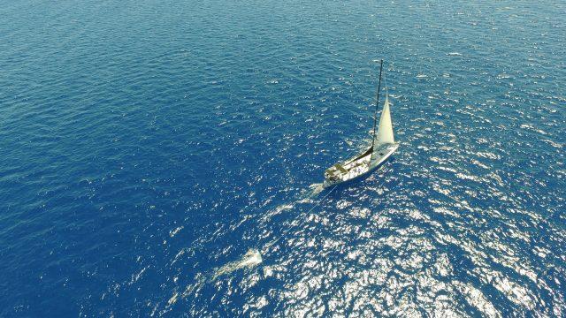 Mega Expedition research vessel deploying manta trawl.