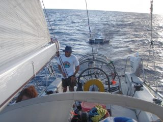 Mega Expedition crew vessel deploying manta trawl.