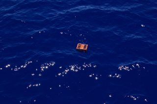 A plastic crate floating in the Great Pacific Garbage Patch, 2015.