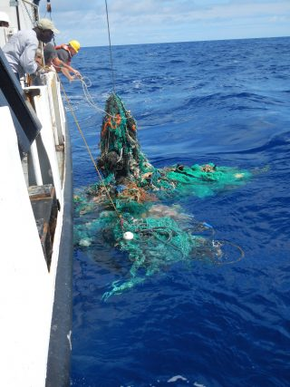 Mega Expedition mothership R/V Ocean Starr crew pulling a ghost net from the Pacific Ocean, 2015.