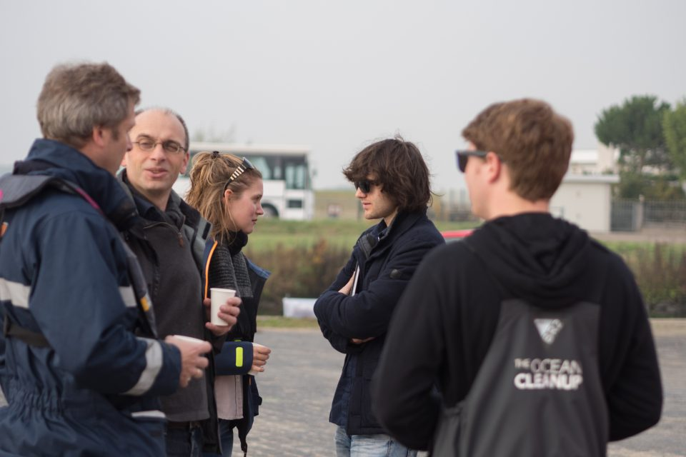 Members of the Adessium Foundation visiting The Ocean Cleanup crew at an early prototype test