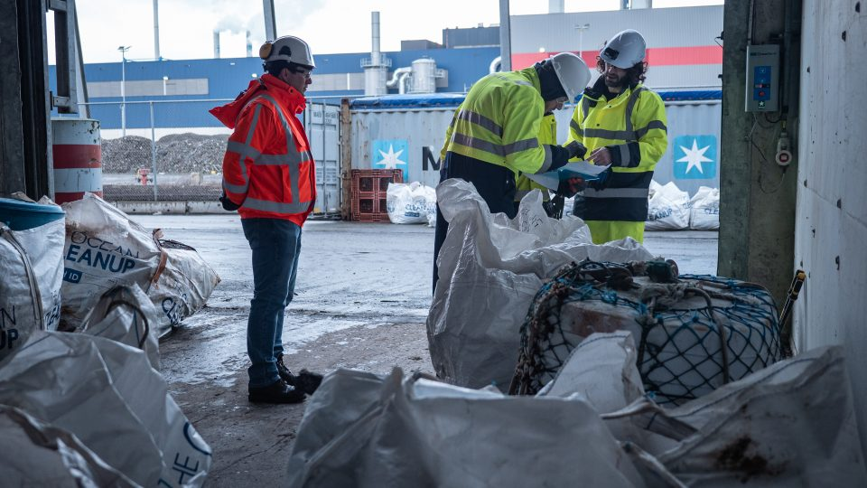 Auditors verifying material log at plastic pre-sorting facility