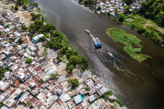 Interceptor 004 being deployed in the Rio Ozama, Santo Domingo, Dominican Republic