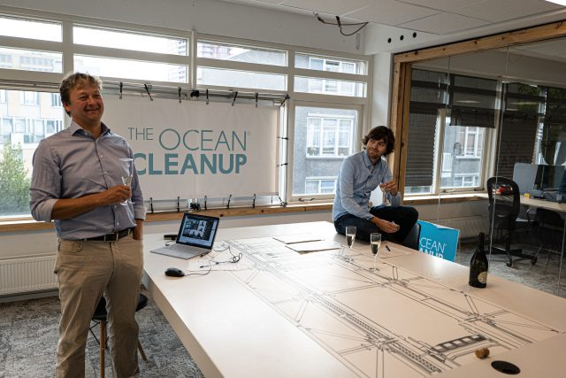 Contract for partnership between The Ocean Cleanup and Konecranes signed and celebrated digitally.